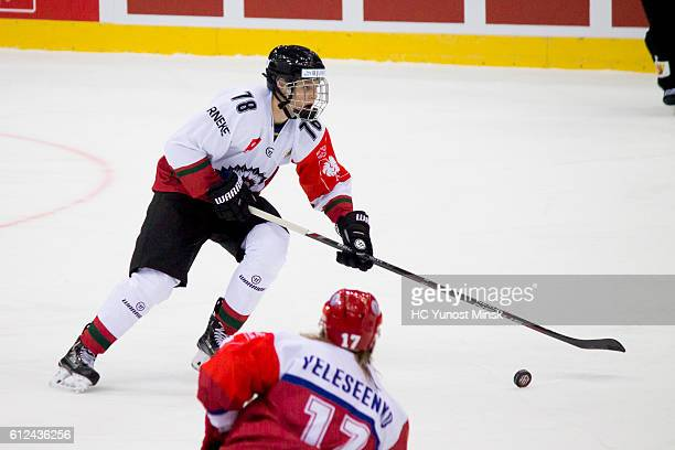 Kristian Vesalainen of Frolunda Gotenburg runs from Anton Yeliseenko of Yunost Minsk during the 1st period of Champions Hockey League Round of 32...