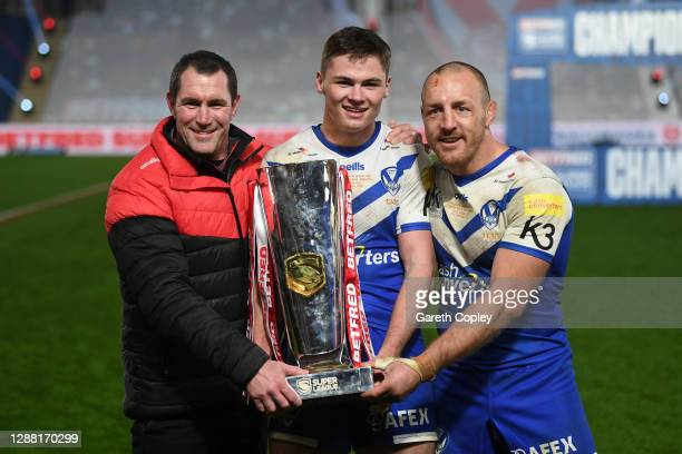 Kristian Woolf, Head Coach of St Helens , try-scorer Jack Welsby and James Roby of St Helens pose with the trophy following victory during the...