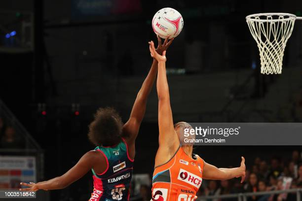 Kristiana Manu'a of the Giants and Mwai Kumwenda of the Vixens compete in the air during the round 12 Super Netball match between the Vixens and the...