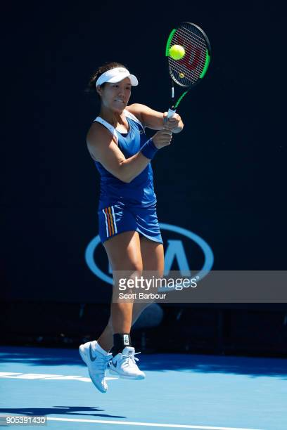 Kristie Ahn of the United States plays a backhand in her first round match against Barbora Strycova of the Czech Republic on day two of the 2018...