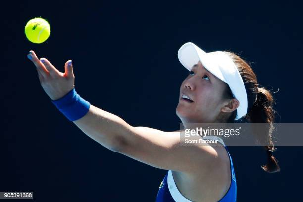 Kristie Ahn of the United States serves in her first round match against Barbora Strycova of the Czech Republic on day two of the 2018 Australian...