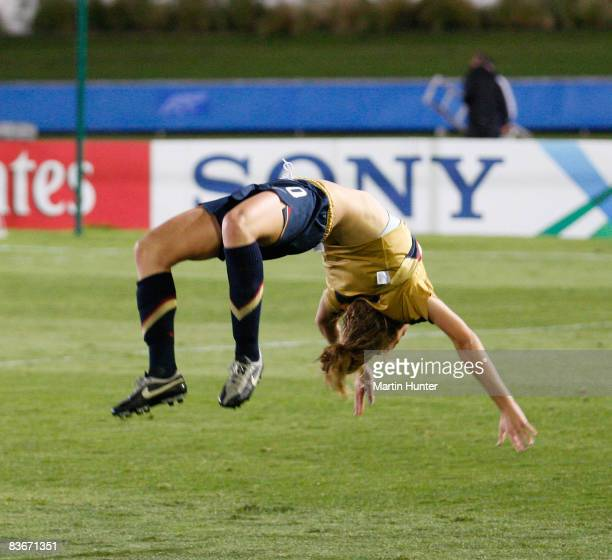 Kristie Mewis captain of the USA does a cartwheel as she celebrates victory during the FIFA U17 Women`s World Cup Semi Final match between Germany...