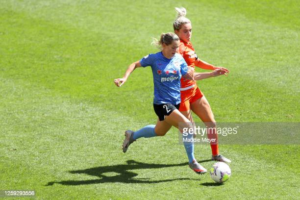 Kristie Mewis of Houston Dash defends Kealia Watt of Chicago Red Stars in the championship game of the NWSL Challenge Cup at Rio Tinto Stadium on...