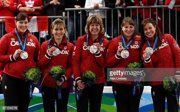 Kristie Moore Cori Bartel Carolyn Darbyshire Susan O'Connor and Cheryl Bernard celebrate winning the silver medal after the women's gold medal...