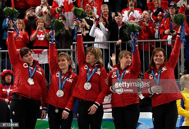 Kristie Moore Cori Bartel Carolyn Darbyshire Susan O'Connor and Cheryl Bernard of Canada celebrate winning the silver medal after the women's gold...