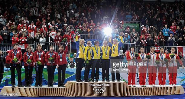 Kristie Moore Cori Bartel Carolyn Darbyshire Susan O'Connor and Cheryl Bernard of Canada celebrate winning the silver medal Kajsa Bergstroem Anna Le...