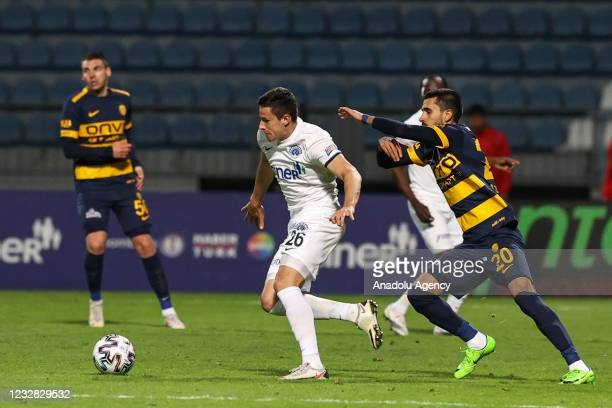 Kristijan Bistrovic of Kasimpasa in action against Alper Potuk of MKE Ankaragucu during the Turkish Super Lig week 41 match between Kasimpasa and MKE...