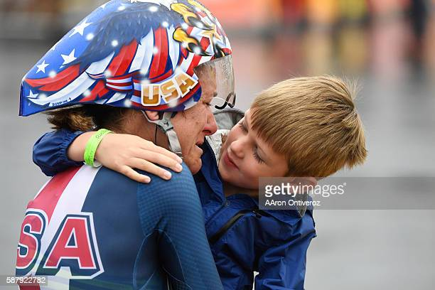Kristin Armstrong hugs her son Lucas Armstrong Savola after she won the gold medal in the women's cycling road individual time trial at Rio 2016 on...