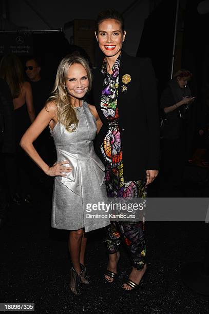 Kristin Chenoweth and Heidi Klum pose backstage at the Project Runway Fall 2013 fashion show during MercedesBenz Fashion Week at The Theatre at...