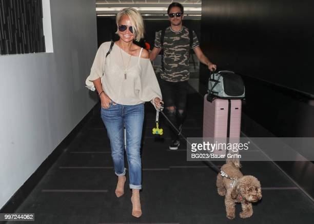 Kristin Chenoweth and her dog Thunder are seen on July 12 2018 in Los Angeles California
