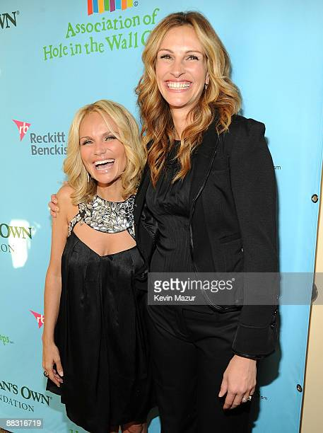 Kristin Chenoweth and Julia Roberts attend the celebration of Paul Newman's Hole in the Wall camps at Avery Fisher Hall at Lincoln Center for the...