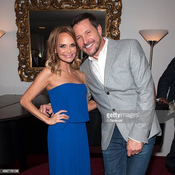 Kristin Chenoweth and Ty Herndon pose backstage after the 'I Am Harvey Milk' Benefit Concert at Avery Fisher Hall Lincoln Center on October 6 2014 in...