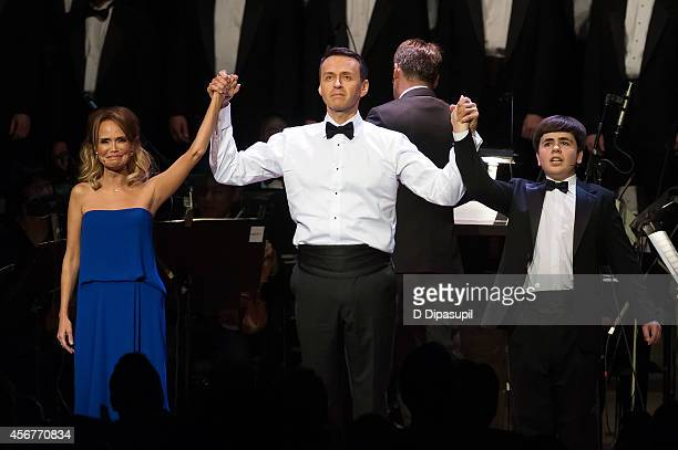 "Kristin Chenoweth, Andrew Lippa, and Noah Marlowe take their curtain call during the ""I Am Harvey Milk"" Benefit Concert at Avery Fisher Hall, Lincoln..."