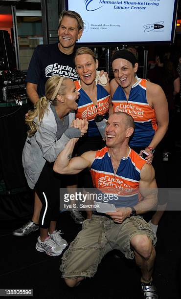 Kristin Chenoweth poses with the Equinox cycling team at the 2012 Cycle For Survival - Day 2 at Equinox Graybar on February 12, 2012 in New York City.
