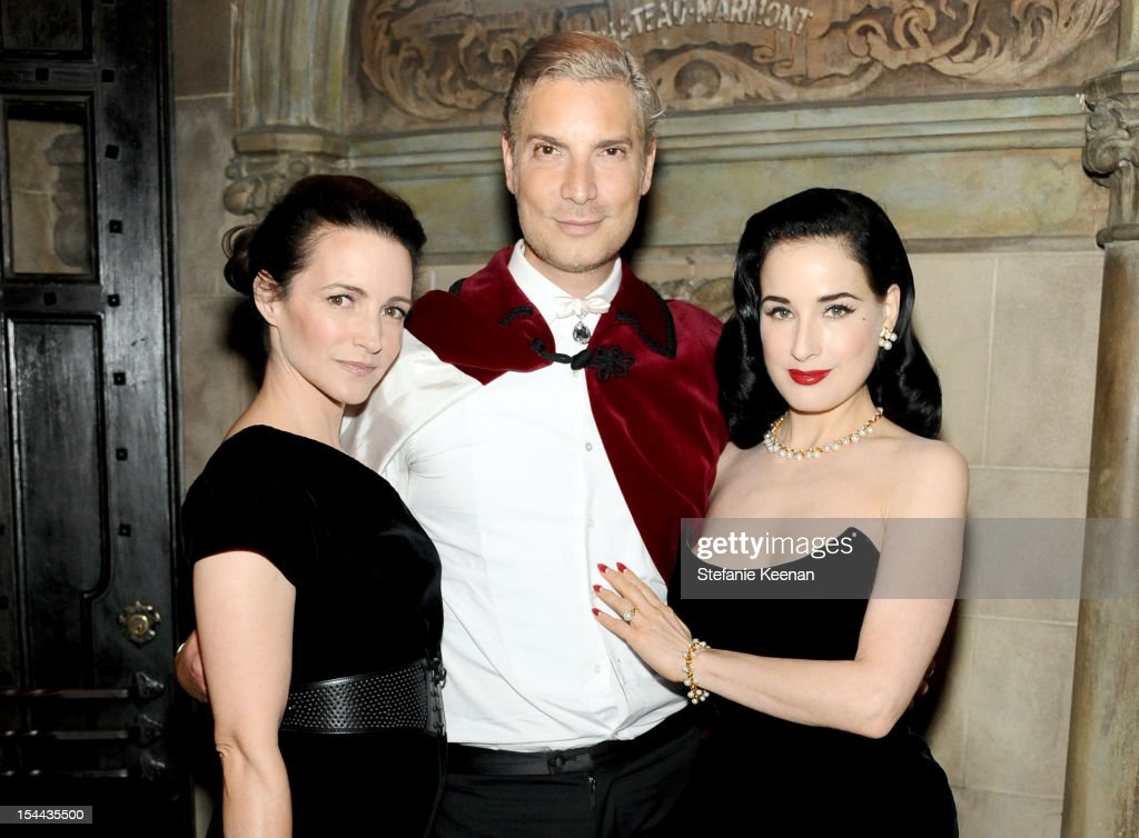 Kristin Davis, Cameron Silver, and Dita Von Teese attend Cameron Silver's 'Decades: A Century Of Fashion' book party hosted by Marina B at Chateau Marmont's Bar Marmont on October 19, 2012 in Hollywood, California.