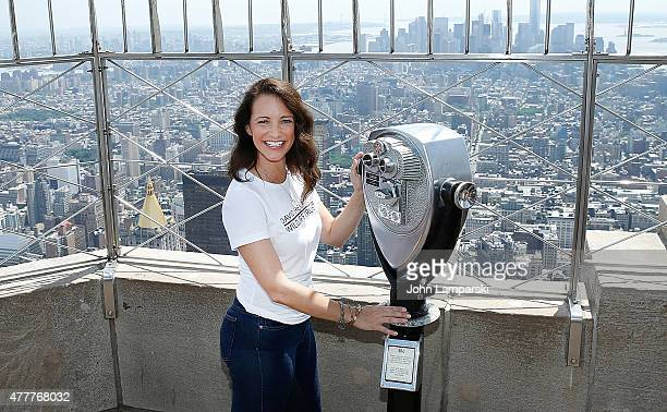 Kristin Davis lights the Empire State Building to raise awareness about the elephant crisis at The Empire State Building on June 19 2015 in New York...