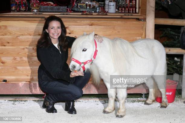 Kristin Davis Sex in the City with pony horse during the Gut Aiderbichl Christmas Market opening on November 13 2018 in Henndorf am Wallersee Austria