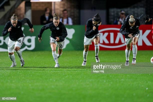 Kristin Demann Linda Dallmann Sara Doorsoun and Isabel Kerschowski warm up prior the UEFA Women's Euro 2017 Quarter Final match between Germany and...