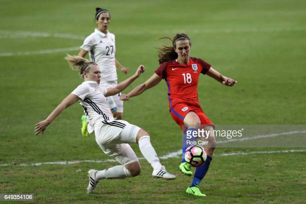 Kristin Demann of Germany and Jill Scott of England go after the ball in the second half during the 2017 SheBelieves Cup at RFK Stadium on March 7...