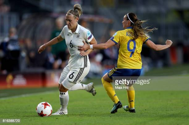 Kristin Demann of Germany and Kosovare Asllani of Sweden compete for the ball during the Group B match between Germany and Sweden during the UEFA...