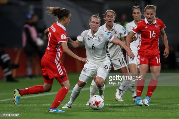 Kristin Demann of Germany and Natalya Solodkaya of Russia battle for the ball during the Group B match between Russia and Germany during the UEFA...