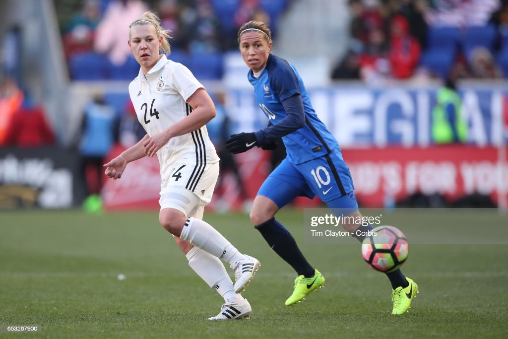 Kristin Demann #24 of Germany challenged by Camille Abily #10 of France during the France Vs Germany SheBelieves Cup International match at Red Bull Arena on March 4, 2017 in Harrison, New Jersey.