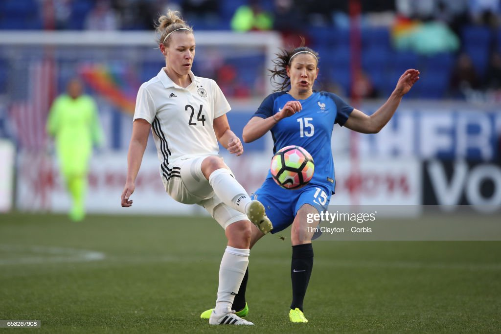 Kristin Demann #24 of Germany challenged by Elise Bussaglia #15 of France during the France Vs Germany SheBelieves Cup International match at Red Bull Arena on March 4, 2017 in Harrison, New Jersey.