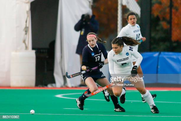 Kristin Donohue of Messiah College and Kelly Coyle of Middlebury College chase a loose ball during the Division III Women's Field Hockey Championship...