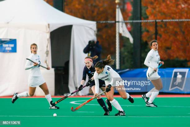 Kristin Donohue of Messiah College and Kelly Coyle of Middlebury College compete for possession during the Division III Women's Field Hockey...