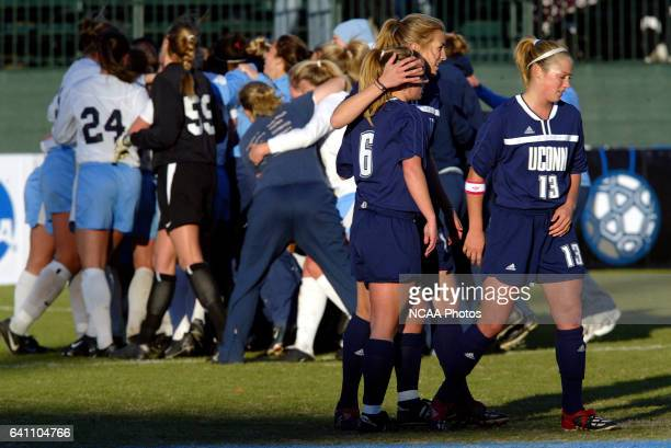 Kristin Fisher Kristen Graczyk and Kathleen Frank of the University of Connecticut console each other after losing to the University of North...
