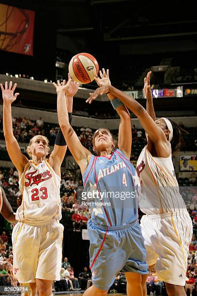 Kristin Haynie of the Atlanta Dream shoots over Katie Douglas and Tammy SuttonBrown of the Indiana Fever at Conseco Fieldhouse on August 30 2008 in...