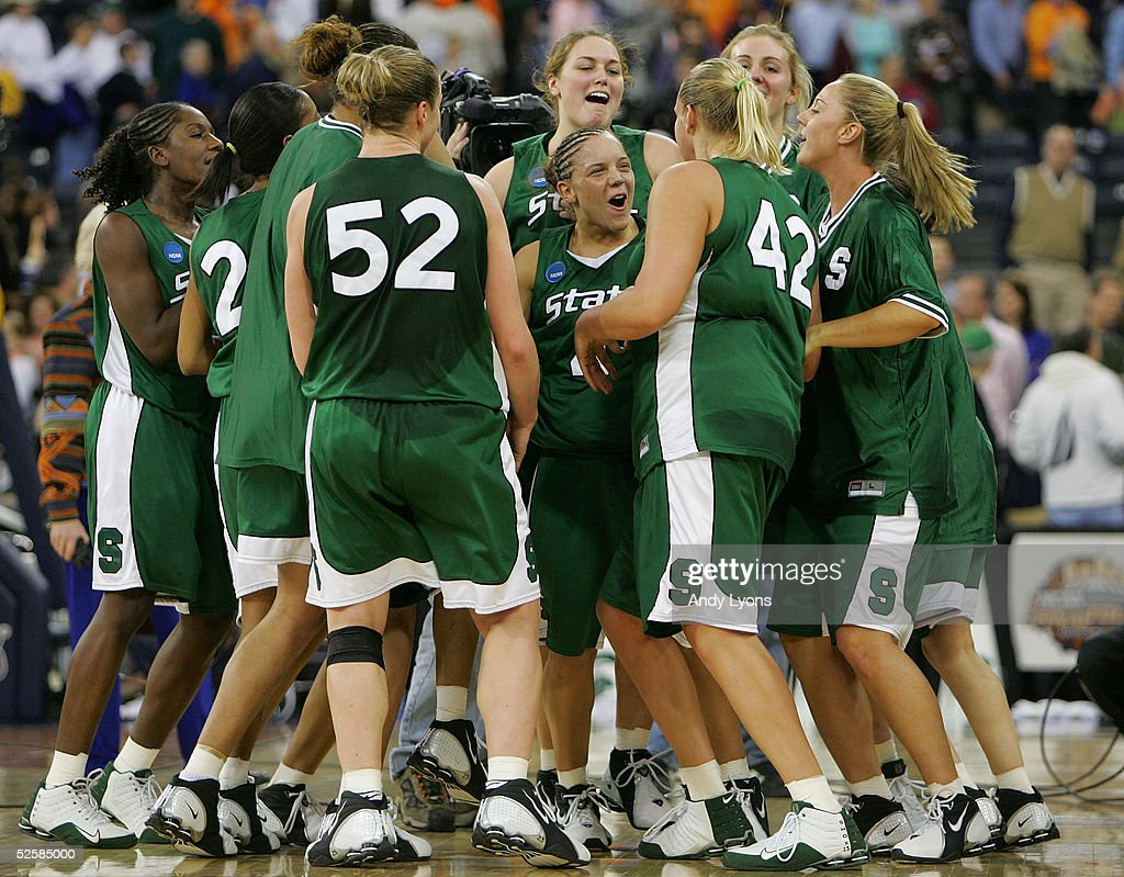 Kristin Haynie #4 of the Michigan State Spartans (center) celebrates with her teammates after defeating the Tennessee Lady Vols in the Semifinal game of the Women's NCAA Basketball Championship on April 3, 2005 at the RCA Dome in Indianapolis, Indiana. Michigan State defeated Tennessee 68-64.