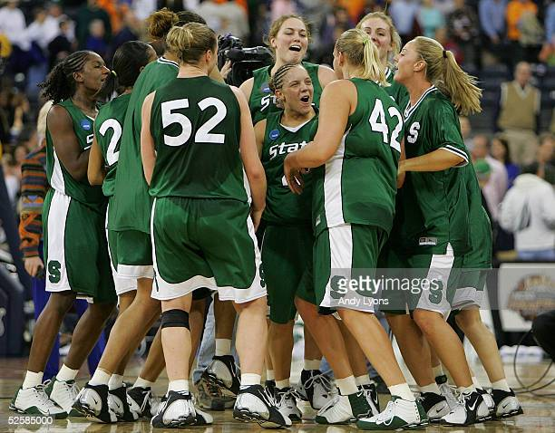 Kristin Haynie of the Michigan State Spartans celebrates with her teammates after defeating the Tennessee Lady Vols in the Semifinal game of the...