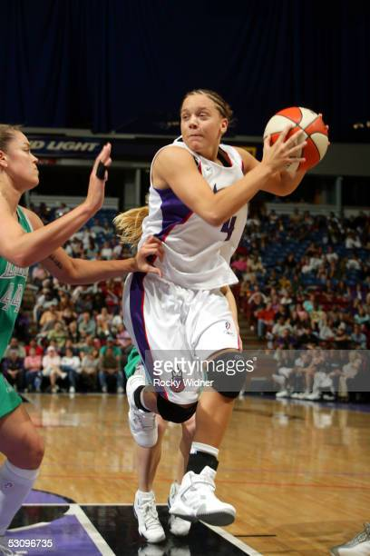 Kristin Haynie of the Sacramento Monarchs looks to pass against Kristen Mann of the Minnesota Lynx during the WNBA game on June 17 2005 at Arco Arena...