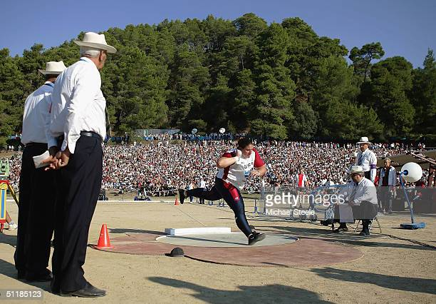 Kristin Heaston of USA makes the first throw in the women's shot put qualifying round on August 18 2004 during the Athens 2004 Summer Olympic Games...