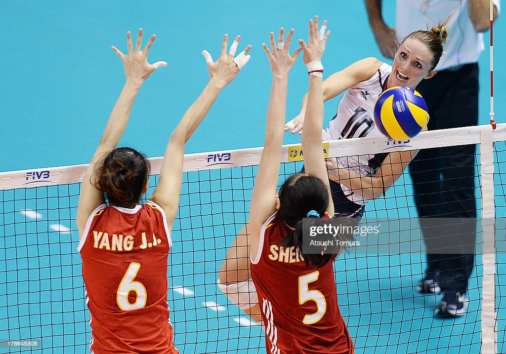 Kristin Hildebrand of USA spikes the ball during day three of the FIVB World Grand Prix Sapporo 2013 match between China and USA at Hokkaido Prefectural Sports Center on August 30, 2013 in Sapporo, Hokkaido, Japan.