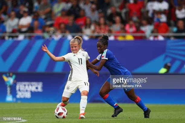 Kristin Koegel of Germany is tackled by Danielle Darius of Haiti during the FIFA U20 Women's World Cup France 2018 group D match between Germany and...