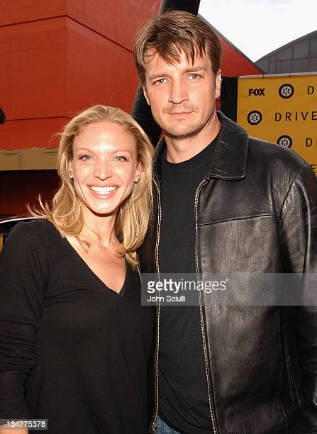 Kristin Lehman and Nathan Fillion during FOX Hosts Drive Roadside Challenge at Universal City Walk in Universal City California United States