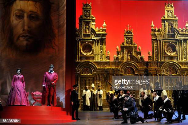 Kristin Lewis as Elizabeth of Valois, Ildar Abdrazakov as Philip II and Bryan Hymel as Don Carlo with artists of the company in the Royal Opera's...