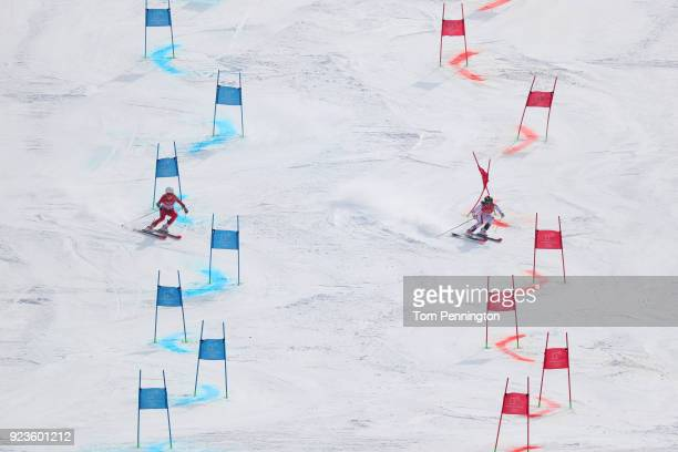 Kristin Lysdahl of Norway and Katharina Liensberger of Austria compete during the Alpine Team Event Semifinals on day 15 of the PyeongChang 2018...