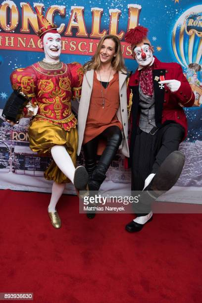 Kristin Meyer and two clowns attend the 14th Roncalli Christmas at Tempodrom on December 16 2017 in Berlin Germany