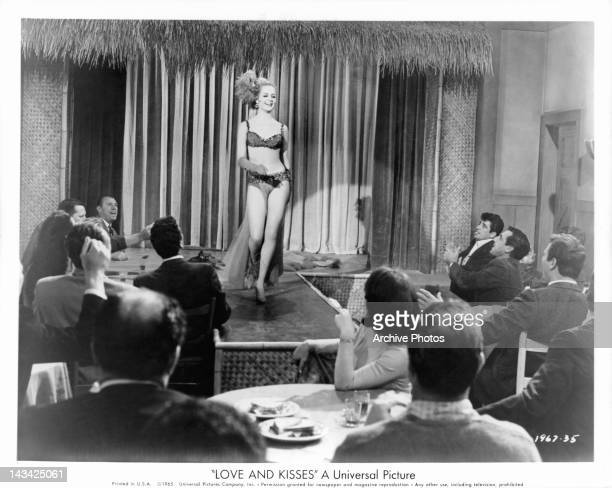 Kristin Nelson becomes an exotic stripper in a dream of her husband in a scene from the film 'Love And Kisses' 1965