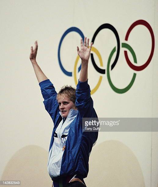 Kristin Otto of East Germany celebrates winning the Women's 100 metres Butterfly final on 23rd September 1988 during the XXIV Summer Olympic Games at...