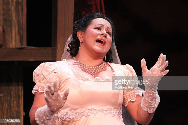 """Kristin Sampson performs the role of Tosca in """"Tosca"""" performed on Opening Night at the Dicapo Opera Theatre on October 4, 2011 in New York City."""