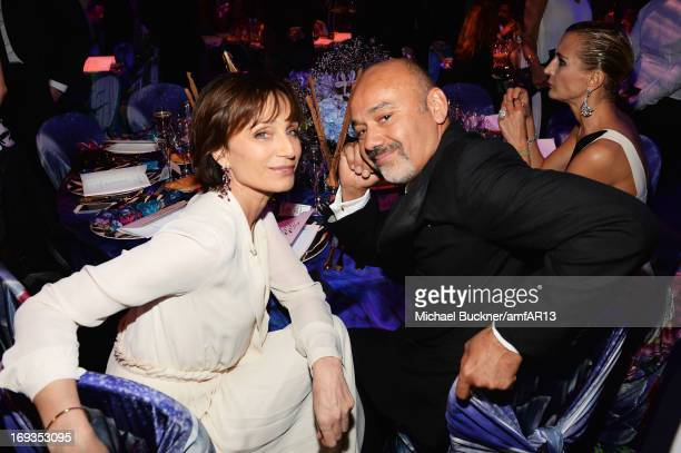 Kristin Scott Thomas and Christian Louboutin attend amfAR's 20th Annual Cinema Against AIDS during The 66th Annual Cannes Film Festival at Hotel du...