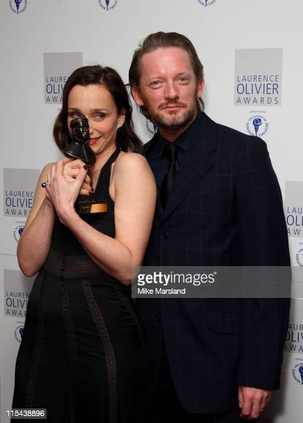 Kristin ScottThomas poses with her Best Actress award and Douglas Henshall in the press room during the Laurence Olivier Awards 2008 at Grosvenor...