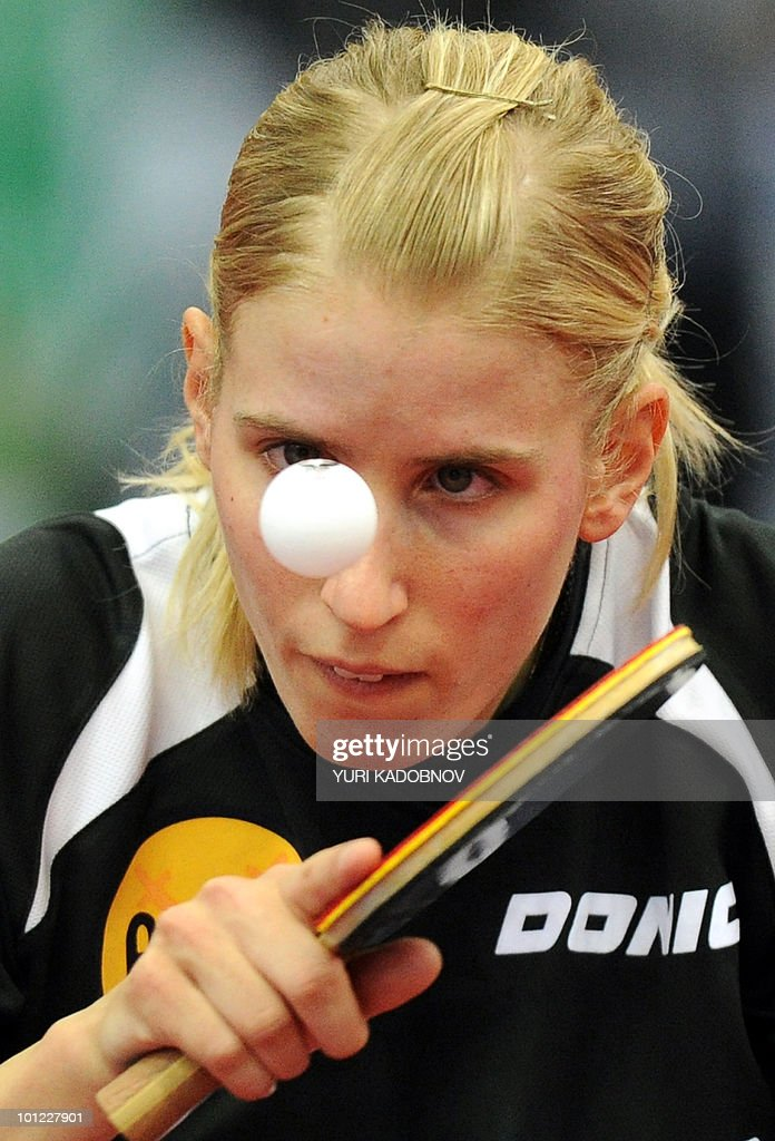 Kristin Sibereisen of Germany returnes a service to Jiang Huajun of Hong Kong during the women's quarter final match at the 2010 World Team Table Tennis Championships in Moscow on May 28, 2010.