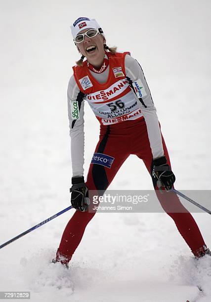 Kristin Steira of Norway celebrates crossing the finish Line of Cross Country women's 10 km classical and free pursuit race in Oberstdorf, 02 January...