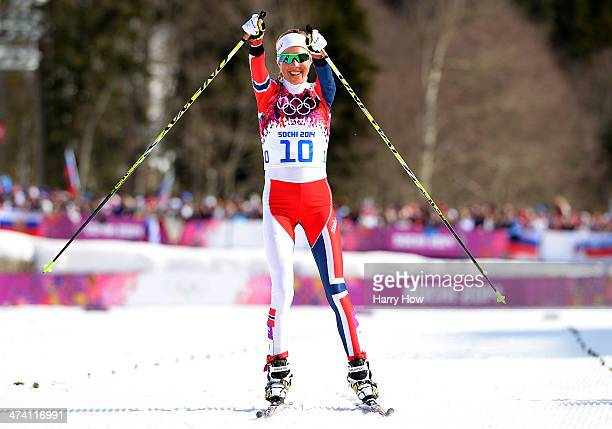 Kristin Stoermer Steira of Norway celebrates crossing the finish line in third place to win the bronze medal in the Women's 30 km Mass Start Free...