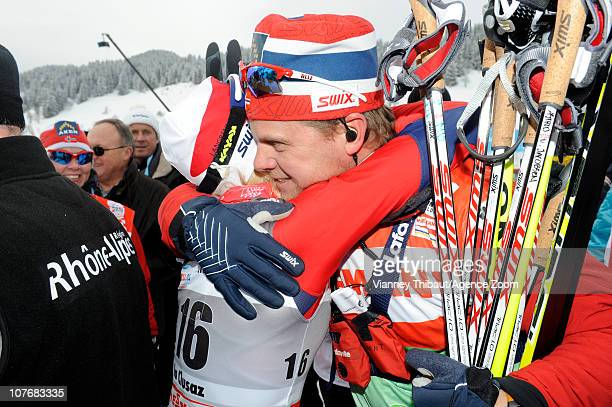 Kristin Stoermer Steira of Norway celebrates taking 3rd place with her coach during the FIS CrossCountry World Cup Women's 15 km Mass Start on...